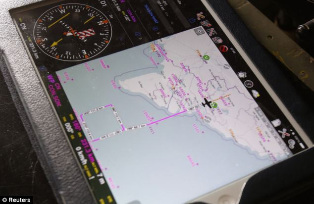 Part of the search area is seen on an iPad of a military officer onboard a Vietnam Air Force AN-26 aircraft