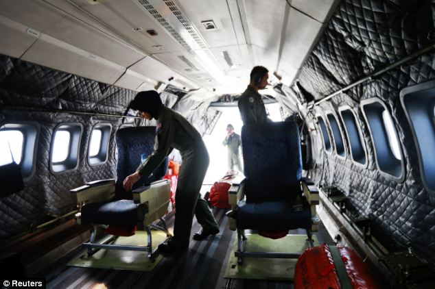 Crew members from the Royal Malaysian Air Force prepare a Malaysian Air Force CN235 aircraft for a Search and Rescue operation to find the missing plane