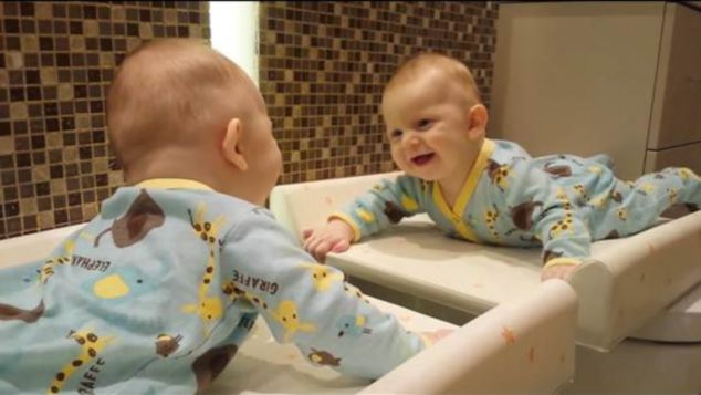 Four-month-old Frederick is having a great time with a mirror