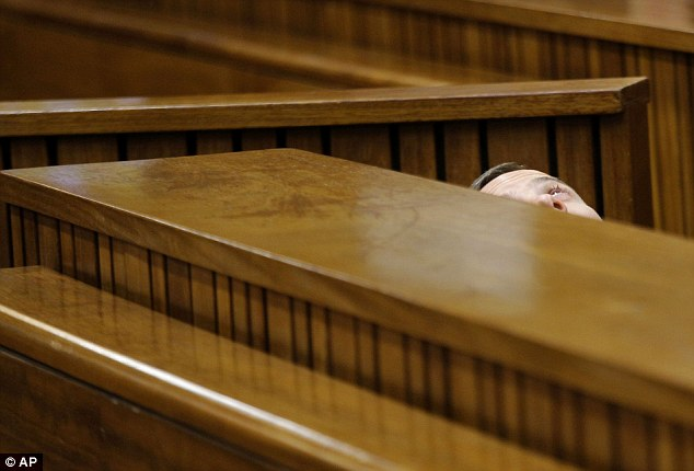 Irritation: Pistorius leans back after applying eye drops before the start of proceedings