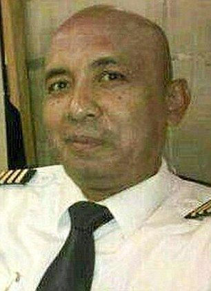 Probe: Police in Kuala Lumpur searched the home of Capt. Zaharie Ahmad Shah, 53, after news the plane was hijacked