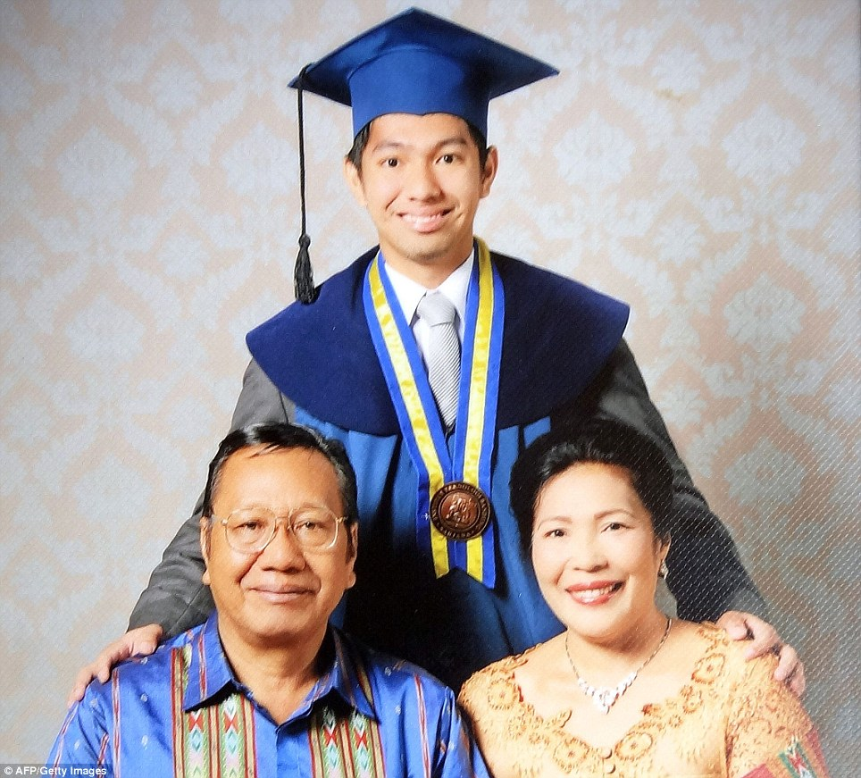 On board: Student Firman Siregar, pictured centre with his family, was one of the 239 aboard Flight MH370
