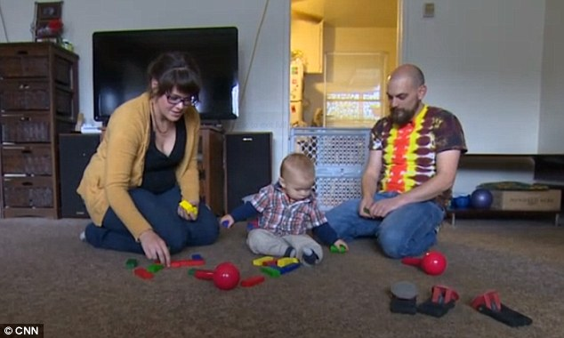 Taken: Medical marijuana users Shawnee and Aaron Hillyer, pictured with their son, are heard in a recording begging to know why authorities had decided to take the 11-month-old child away