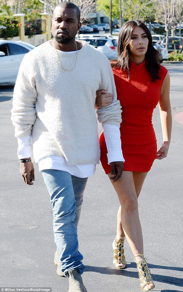 Trouble with the law: Kanye West, pictured with fiancée Kim Kardashian on Friday, will have to enter anger management therapy after a Monday plea deal