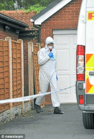 Forensic experts at the property in Walsall, West Midlands, after the charred remains of 24-year-old Varkha Rani were found by police in an incinerator in the back garden