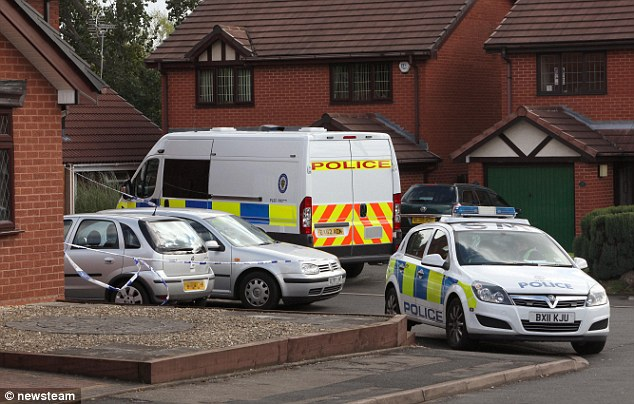Police at the scene of Jasvir Ram Ginday and Varkha Rani's house in Walsall, West Midlands, after her body was found in an incinerator in the back garden of the property