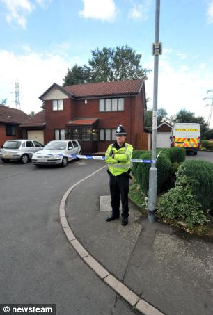 Police at the property in September last year after Mrs Rani's body was discovered