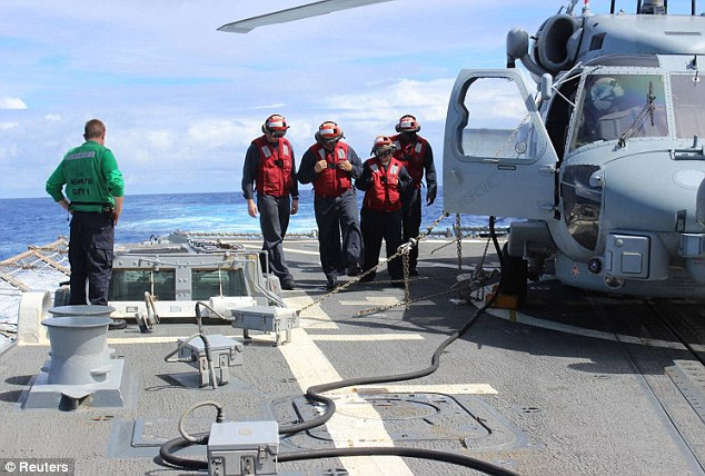 Search: Sailors from the U.S. destroyer USS Kidd prepare to launch a helicopter in the hunt for flight MH370