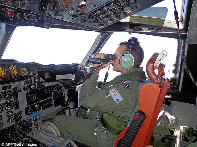 Hunt: An Australian pilot scans the surface of the sea during the search operation for the missing Malaysia Airlines Flight MH370 to the west of Peninsula Malaysia
