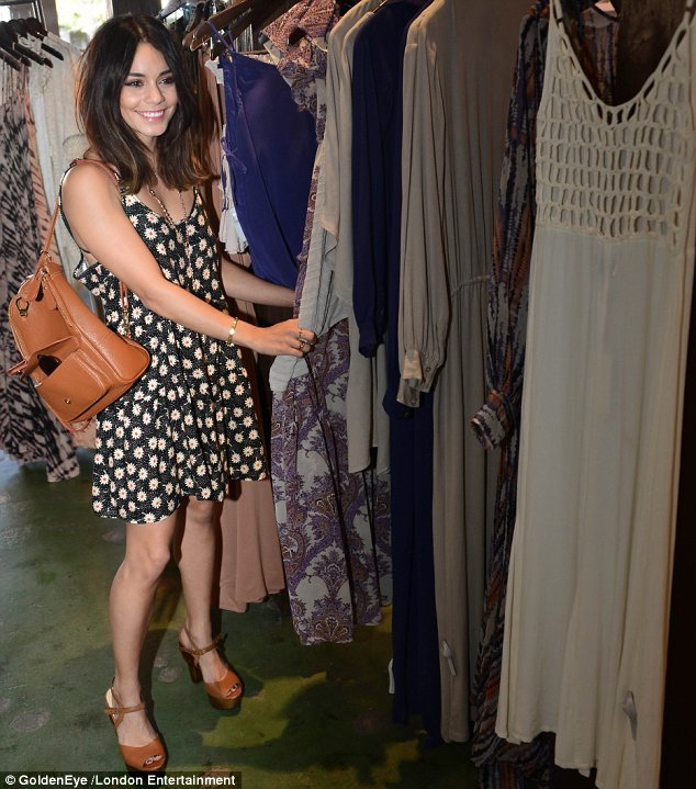All for me? Vanessa's eyes lit up as she took in the array of dresses to choose from ahead of her trip to the annual music festival