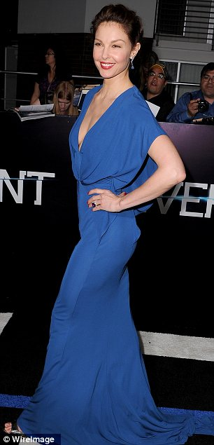 Attention grabbing: While Ashley Judd plays Tris' drab mother in the movie, she made sure she stood out in a dramatic plunging dress at the premiere