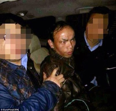 Arrest: Xiang Jan,39, killed his ex-girlfriend, her mother, her sister and her niece with an axe after her family banned her from seeing him