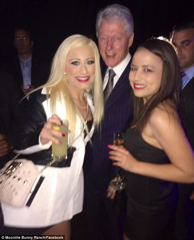 Latest ladies: Clinton was pictured posing for a photo with Barbie Girl (left) and Ava Adora (right), two known prostitutes who work at the Bunny Brothel in Nevada