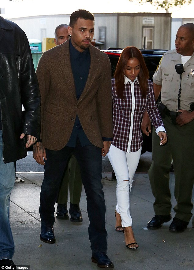 Always there: Sources say the model is upset that she was there for Chris at his February 3 court appearance but he was still talking to other women