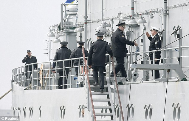 Shaking hands: Russian officers meet Ukrainian colleagues on the ship Slavutich in Sevastopol
