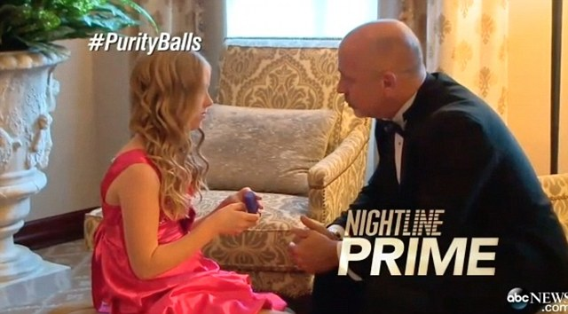 Ron Johnson, who is the head pastor at the Living Stones Church, kneels to present one of his younger daughters with her purity ring in the new documentary exploring the growing phenomenon of father daughter purity balls