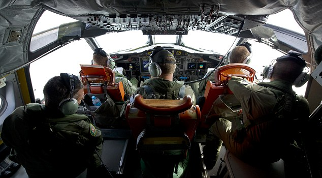 Aerial search: the view from the flight deck of an Orion aircraft over the southern Indian Ocean