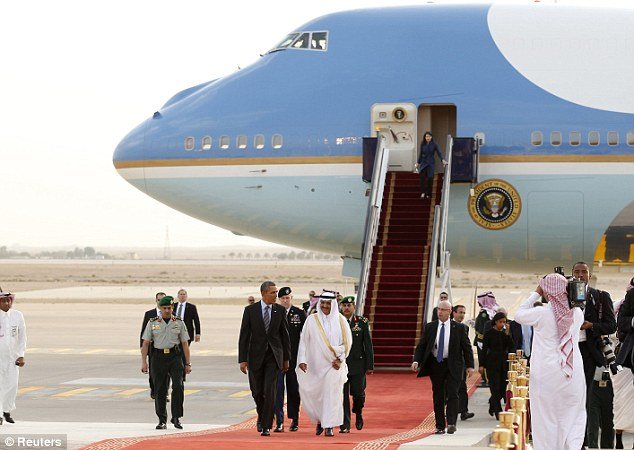 Red carpet: President Obama is greeted after arriving in Riyadh, Saudi Arabia aboard Air Force One
