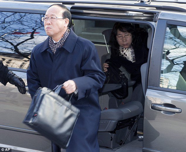 Slain York University student Liu Qian's father Liu Jianhui and mother Zheng Yaru, right,  arrive at court in Toronto on Monday, March 24, 2014 for the trial of Brian Dickson