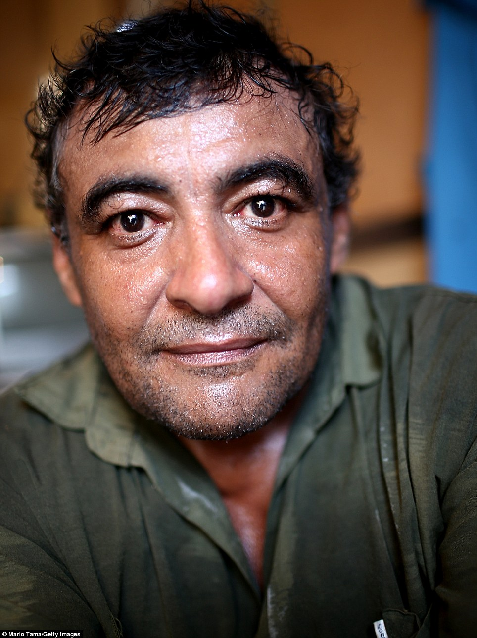Joao Batista da Silva lives in the slum. A clean-up operation began on Rio's biggest slum Rocinha in 2011. In the clean-up helicopters circled the slum and troops charged into the favela in bullet-proof clothing
