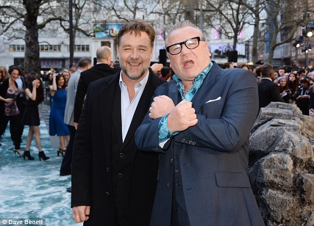 Manly moment: Russell Crowe and Ray Winstone look animated as they catch up with one another
