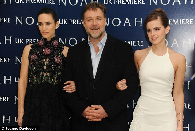 He's a lucky boy: Inside the venue, Russell Crowe posed with Emma Watson on one arm and Jennifer on the other