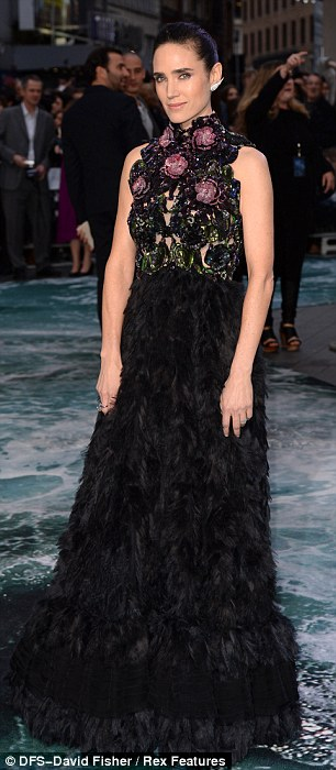 Intricate: The high-necked gown had a shimmering floral bodice which had a lacy cut-out design and a fur full-bodiced black skirt