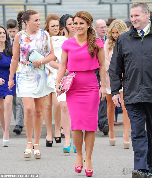 Pretty in pink: Putting on a rather vibrant display, the WAG was dressed head-to-toe in bright fuchsia as she left her parents' home to head to the annual race meeting