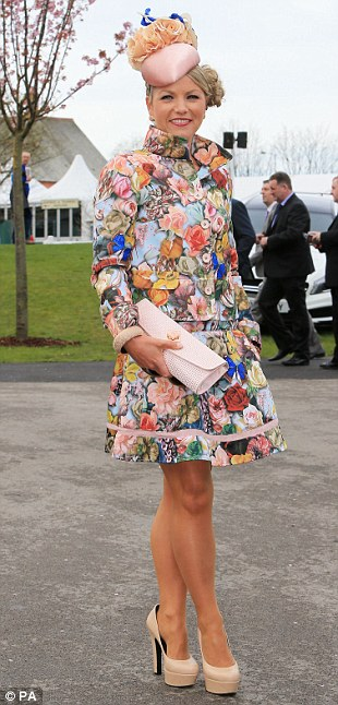 In bloom: A racegoer opts for a stunning floral ensemble topped with an eye-catching hat