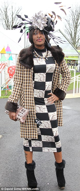 Now that's what you call a hat! A racegoer in a vast fascinator and fur lined boots