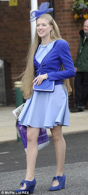 Looking good: A racegoer's blond Rapunzel-like locks are set off to perfection by her lilac outfit