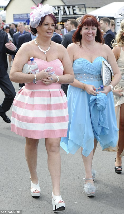 A pair of racegoers show off their summery outfits