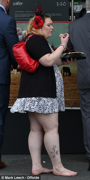 Ouch! This lady's shoes clearly proved a little too painful to wear, leaving her barefoot at Aintree