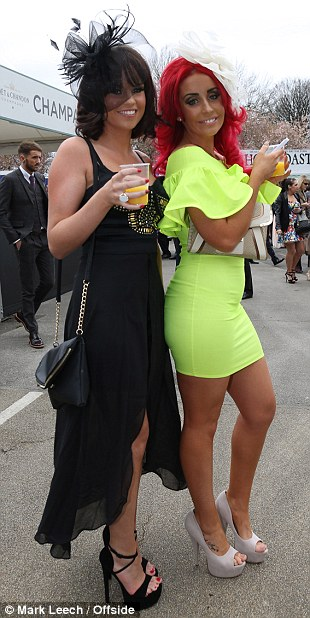 Bright stuff! A racing aficionado combines her lime green dress with crimson hair
