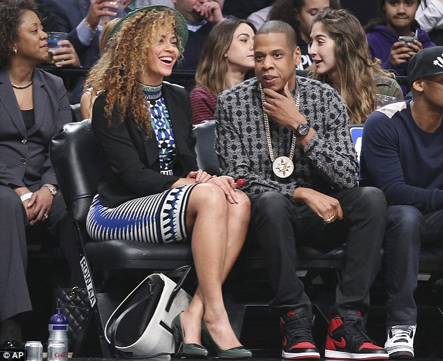 Fashion choice: Rapper Jay-Z turned heads at the Brooklyn Nets game on Tuesday when he wore a Five Percent Nation medallion