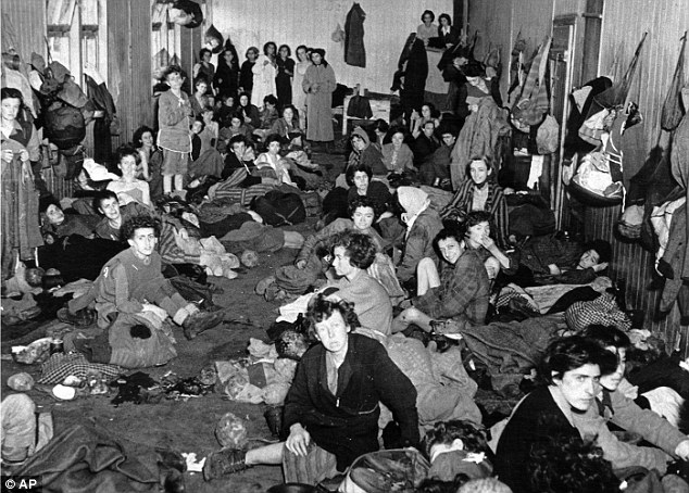 Cramped: Female inmates at Bergen-Belsen concentration camp, many of them sick and dying of typhus and starvation, wait inside a barrack in 1945