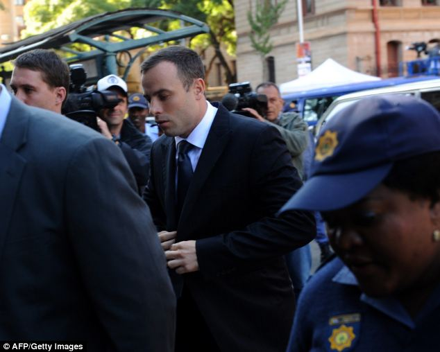 South African paralympic athlete and murder-accused Oscar Pistorius arrives at the high court in Pretoria prior to a hearing of his trial on Thursday