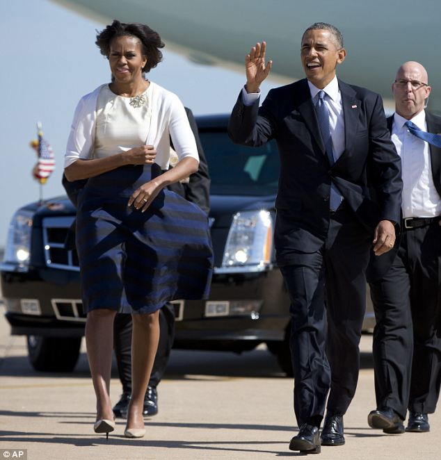 Blustery: The First Couple were even fighting the wind as they walked across the tarmac at Austin-Bergstrom International Airport
