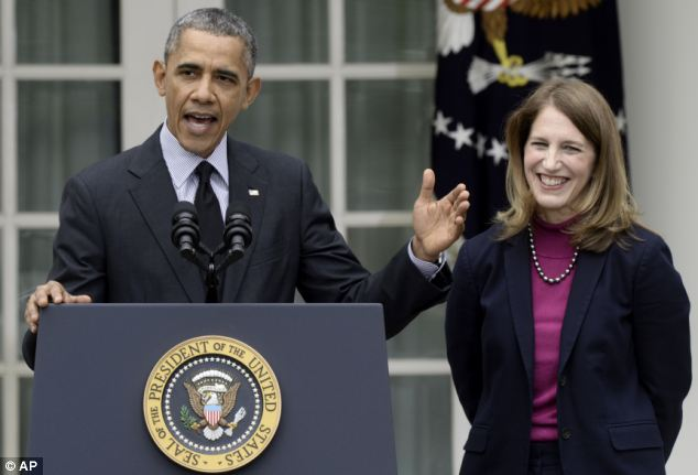 New HHS Secretary nominee Syliva Burwell, who now heads the Office of Management and Budget, beamed as she accepted praise from the boss and applause from a partisan crowd