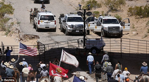Protesters arrive at the Bureau of Land Management's base camp where cattle that were already seized are being held