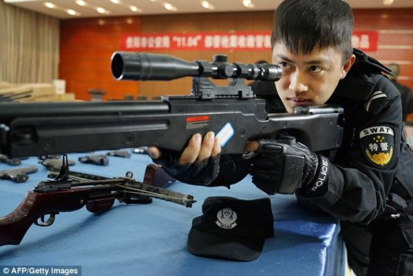 China seizes huge cache of illegal weapons including