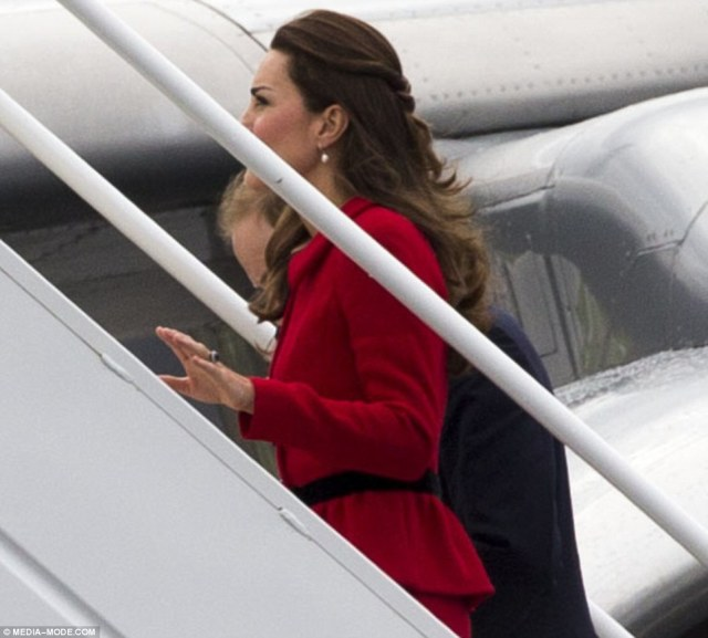 Lots to talk about: The Duchess chatted to her husband as they made their way up the stairs of their private plane
