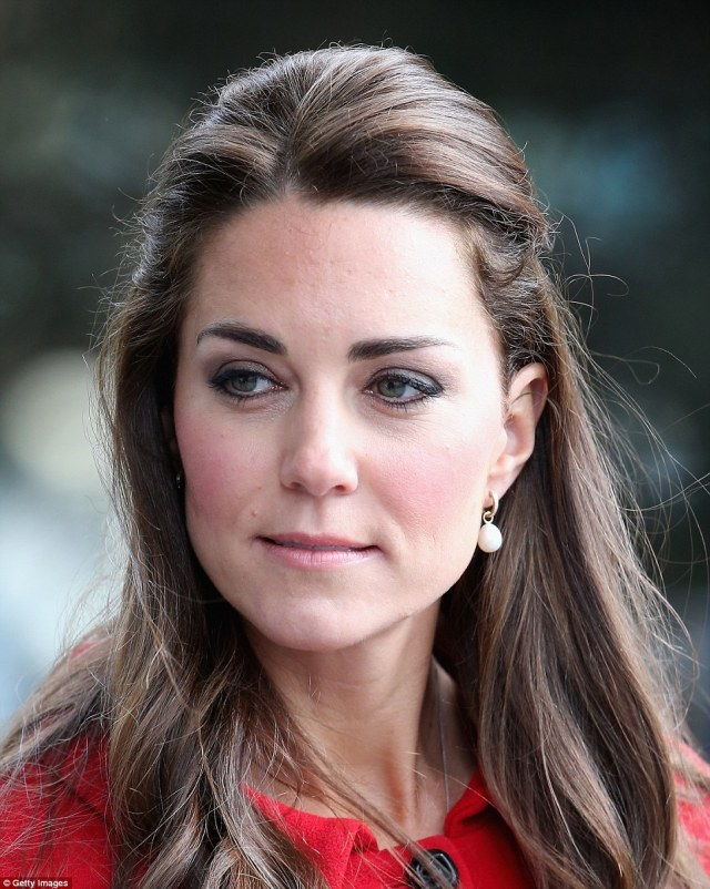 Signature look: Kate accentuated her eyes with a signature application of heavy black eyeliner
