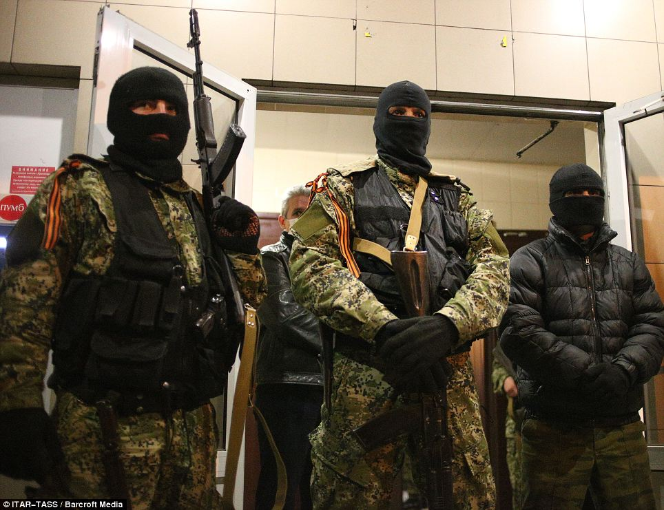 'Left of their own accord': This photo taken on Saturday shows the armed men who were occupying the police headquarters in Kramatorsk