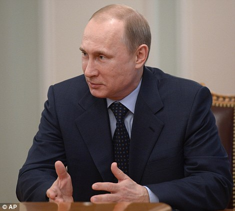 Russian President Vladimir Putin speaks during a meeting at the Novo-Ogaryovo residence outside Moscow