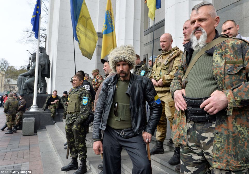 Maidan self-defence activists guard the Ukrainian parliament in Kiev during a session on Tuesday