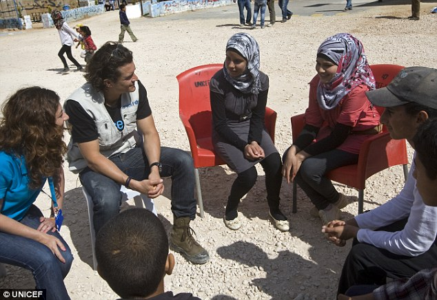 Listening: The 37-year-old speaks with young refugees about their life in the camp