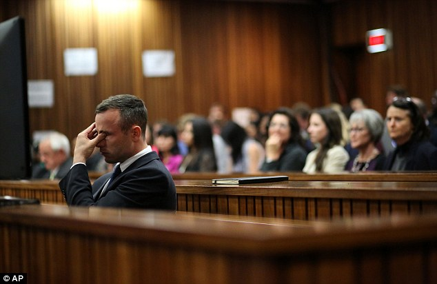 Gruelling stint on the stand: Oscar Pistorius shows the strain at the end of seven days of questioning in the witness box about his relationship with Reeva Steenkamp and the night he shot her dead