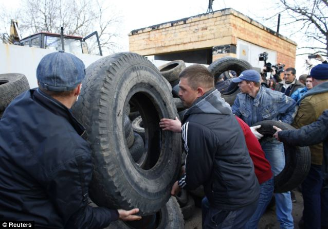 Meanwhile, pro-Russian protesters attempt to barricade the same airbase in Kramatorsk, in eastern Ukraine
