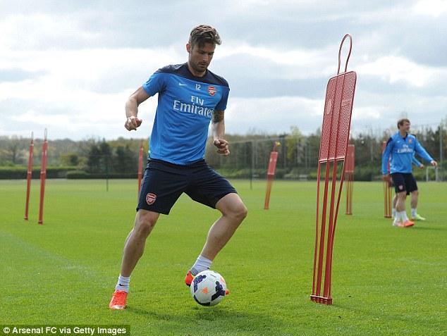 On the ball: Giroud in training ahead of Arsenal